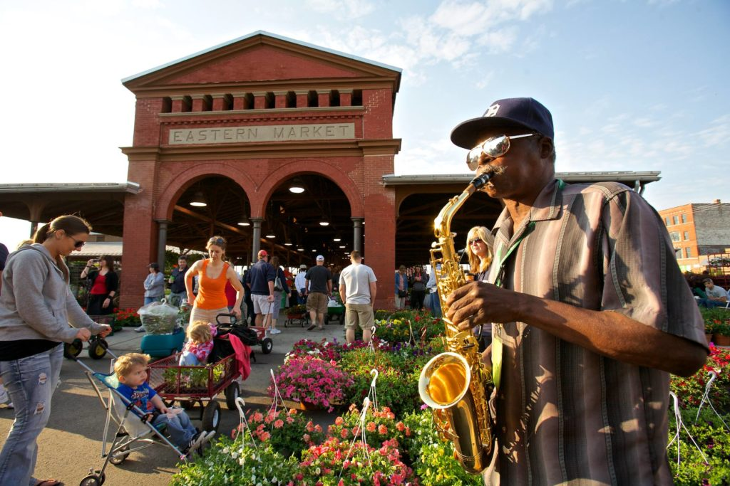 eastern market building with street performer
